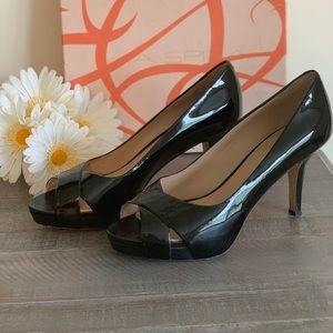 Via Spiga black patent leather heel.